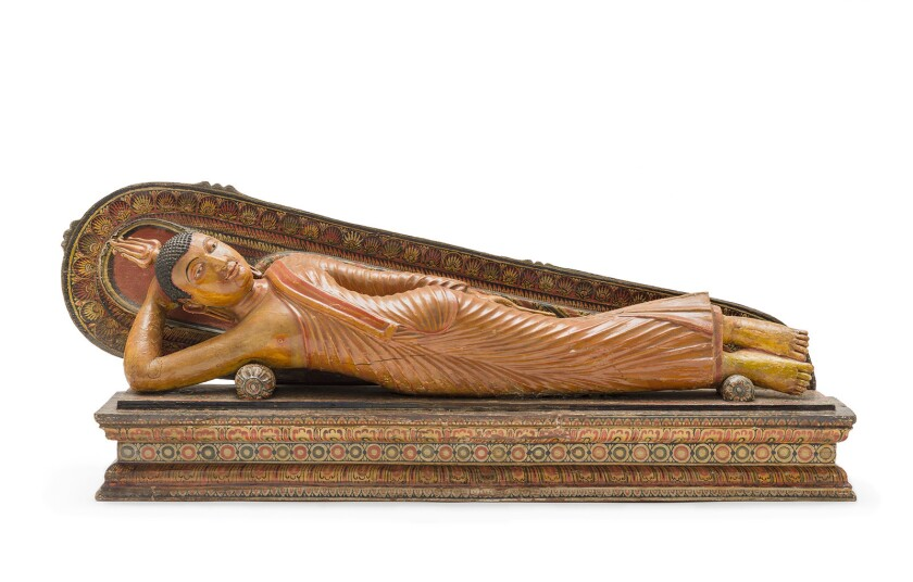 """This 18th-century wooden sculpture of a reclining Buddha is among the objects on display in the new exhibition """"The Jeweled Isle: Art from Sri Lanka"""" at LACMA."""