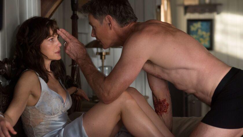 "Bruce Greenwood and Carla Gugino in ""Gerald's Game"" on Netflix. 'Äã'Äã"