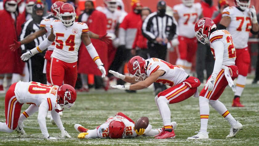 Kansas City Chiefs strong safety Tyrann Mathieu, below, reacts with teammates after picking up a fumble during the first half of an NFL football game against the Denver Broncos, Sunday, Oct. 25, 2020, in Denver. (AP Photo/Jack Dempsey)