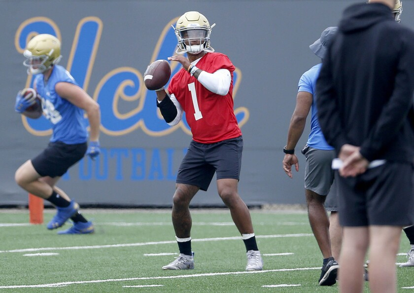 UCLA quarterback Dorian Thompson-Robinson throws in practice on July 31.
