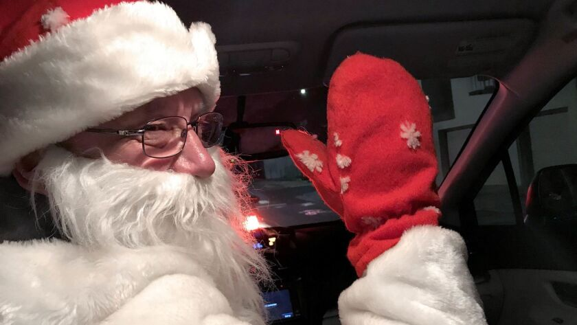 A Lyft driver in San Francisco delivering some yule time cheer from the driver's seat. (Robin Abcari
