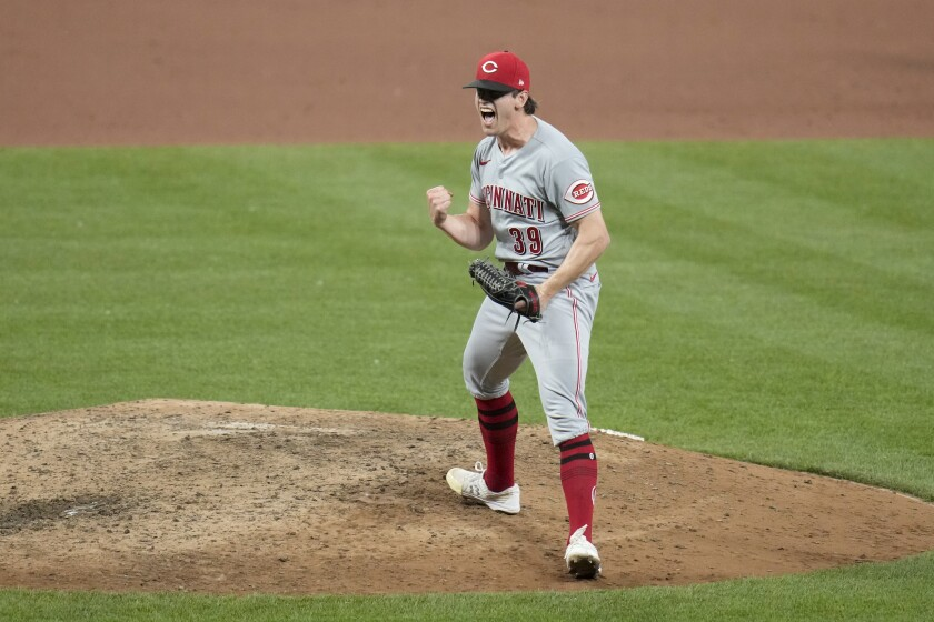 Cincinnati Reds pitcher Lucas Sims celebrates after striking out St. Louis Cardinals' Tommy Edman for the final out of a baseball game Thursday, June 3, 2021, in St. Louis. The Reds won 4-2. (AP Photo/Jeff Roberson)