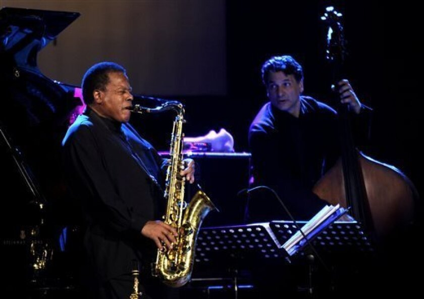 FILE - In this Oct. 20, 2011 file photo, the American jazz saxophonist Wayne Shorter, left, performs with John Patitucci on bass during Skopje Jazz Festival, in Macedonia's capital Skopje. Saxophonist-composer Wayne Shorter is a triple-winner in the 2013 Jazz Awards presented by the Jazz Journalists Association. Shorter, who was a member of Miles Davis' legendary mid-'60s quintet and co-founded the fusion band Weather Report, won awards for Lifetime Achievement in Jazz, top soprano saxophonist a
