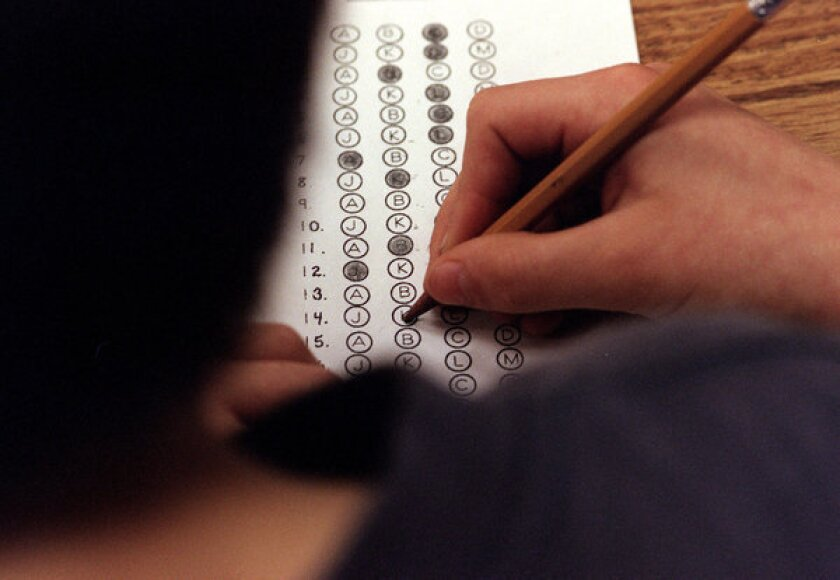A student fills in his answer to the practice test question for a standardized test.