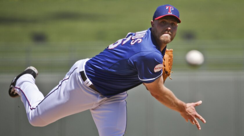 Texas Rangers relief pitcher Jon Edwards, who started for the Rangers, throws in the first inning of a spring training baseball game against the San Diego Padres, Saturday, March 28, 2015, in Surprise, Ariz. (AP Photo/Lenny Ignelzi)