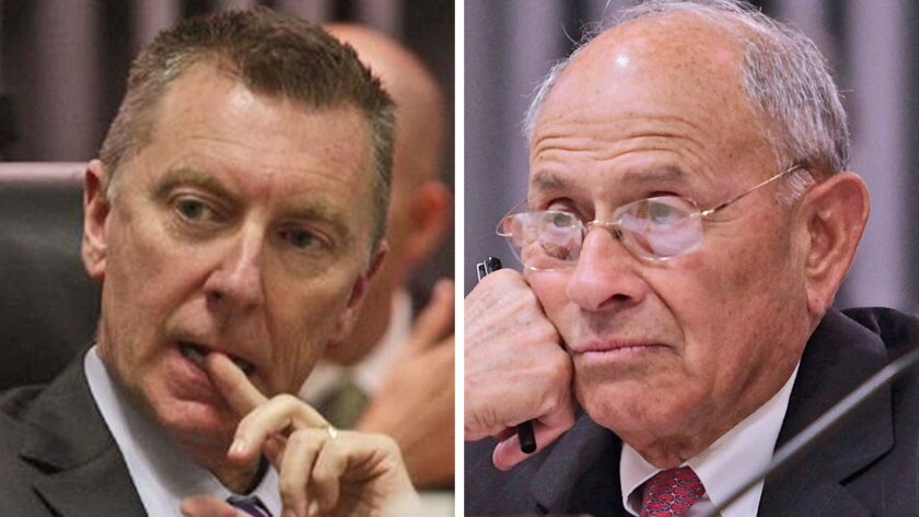 John Deasy, left, was removed as LAUSD superintendent and former Supt. Ramon Cortines was installed as his interim replacement Thursday morning.