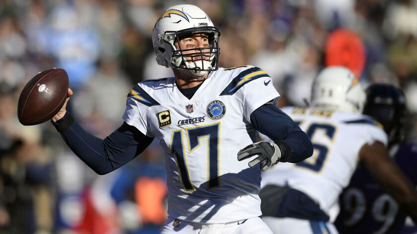 Los Angeles Chargers quarterback Philip Rivers throws a pass in the first half of an NFL wild card p