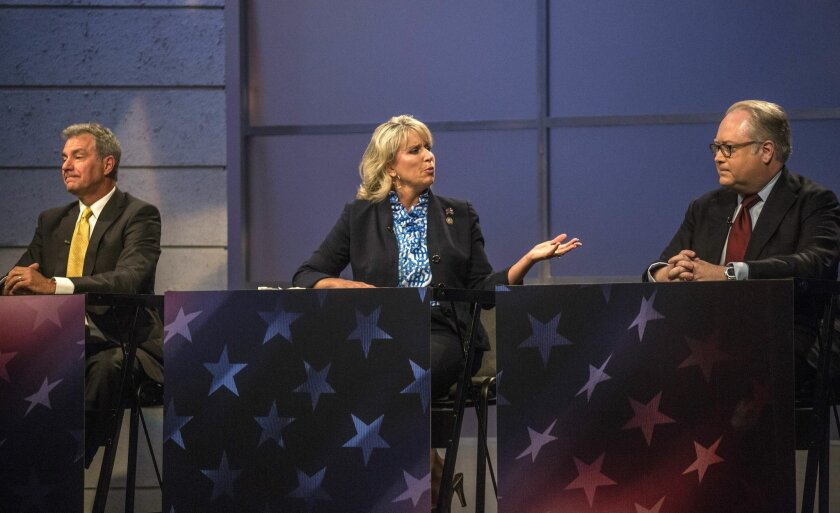 In this Thursday, May 19, 2016 photo, from left, Dr. Greg Brannon, Rep. Renee Ellmers and Rep. George Holding face off during the 2nd Congressional District Republican primary debate at WRAL studio in Raleigh, N.C. (Travis Long/The News & Observer via AP, Pool)