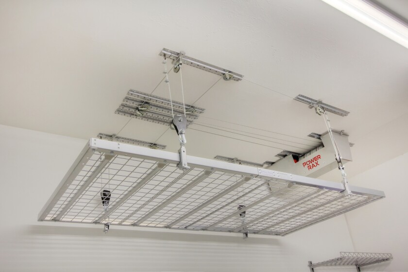 This motorized platform by  Power Rax has a 500 lb. capacity for overhead storage.