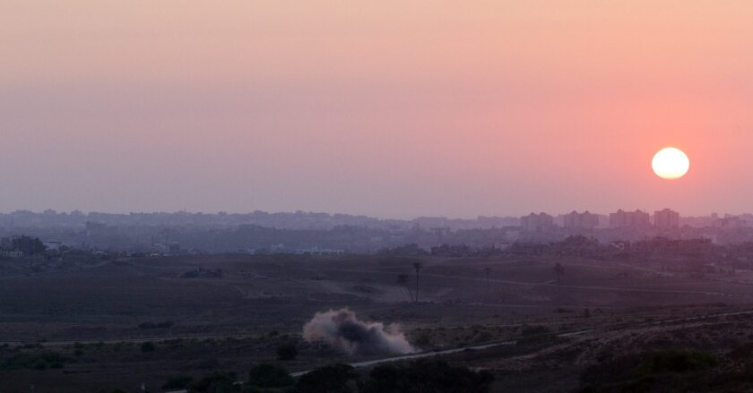 A mortar shell fired by Palestinian militants inside the Gaza Strip explodes near the border with Israel just before sunset Monday. Iranian officials say they have provided weapons technology to Hamas militants to defend Palestinians from Israeli forces.