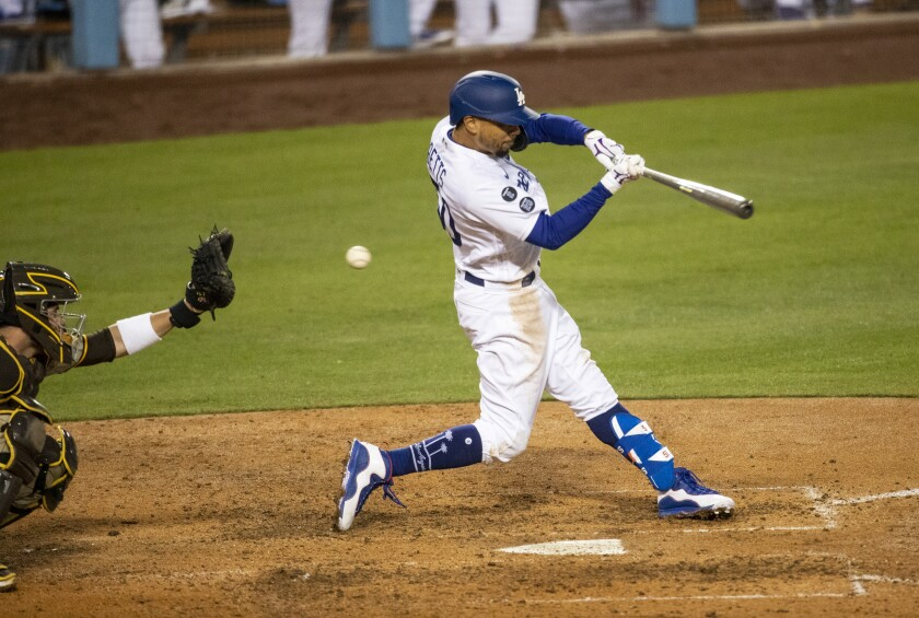 Mookie Betts of the Dodgers strikes out to end a game on April 22 against the Padres.