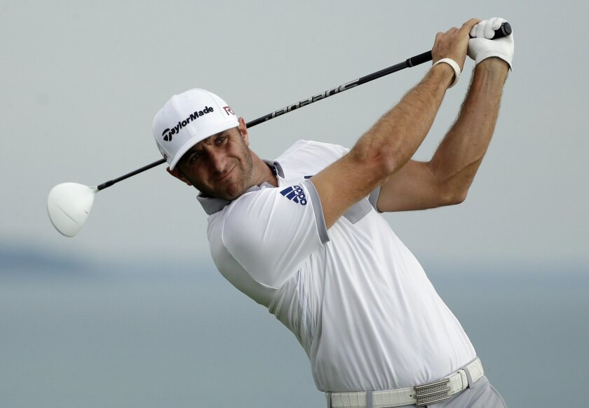 Dustin Johnson hits a drive on the 16th hole during the first round of the PGA Championship golf tournament Thursday, Aug. 13, 2015, at Whistling Straits in Haven, Wis. (AP Photo/Jae Hong)