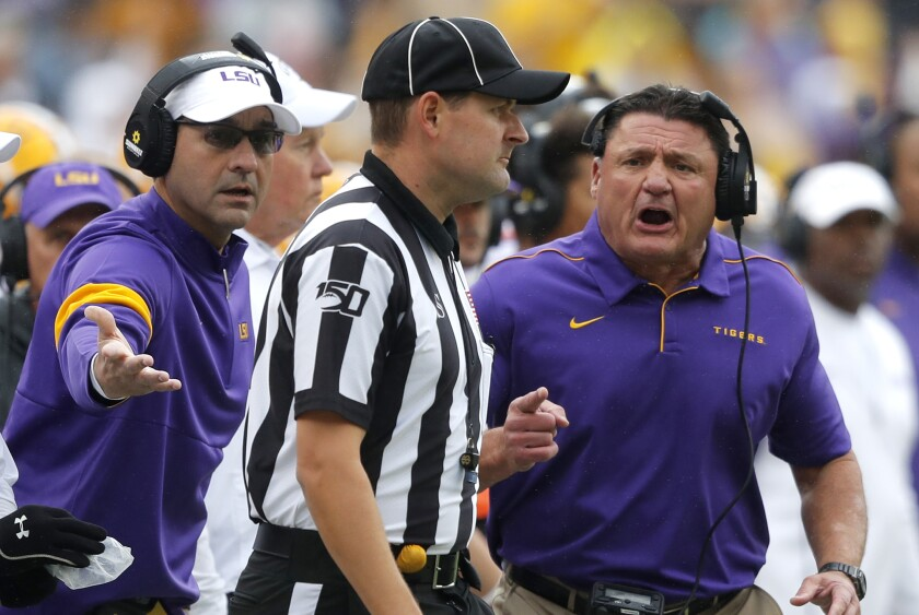 LSU coach Ed Orgeron, right, challenges an official during a game against Auburn in October.