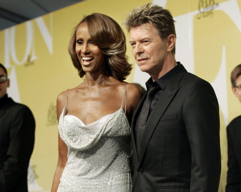 In this June 6, 2005 file photo, singer David Bowie and his wife Iman pose at the 2005 CFDA Fashion Awards in New York. Bowie, the innovative and iconic singer whose illustrious career lasted five decades, died Sunday, Jan. 10, 2016, after battling cancer for 18 months. He was 69 (AP Photo/Stuart R
