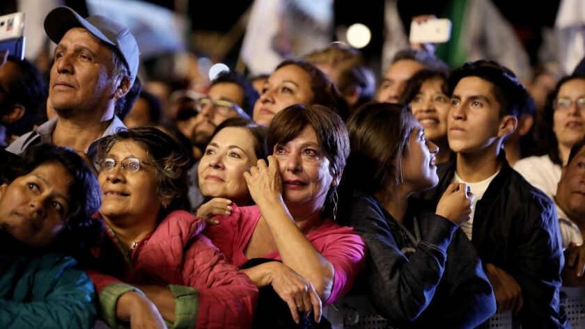 MEXICO CITY, -- SUNDAY, JULY 1, 2018: A woman weeps while supporters of Andrés Manual López Obrador
