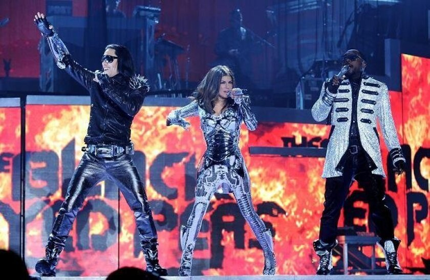 Singers Taboo, Fergie and will.i.am of the Black Eyed Peas perform at the Staples Center on March 29, 2010 in Los Angeles, California. (Photo by Kevin Winter/Getty Images)