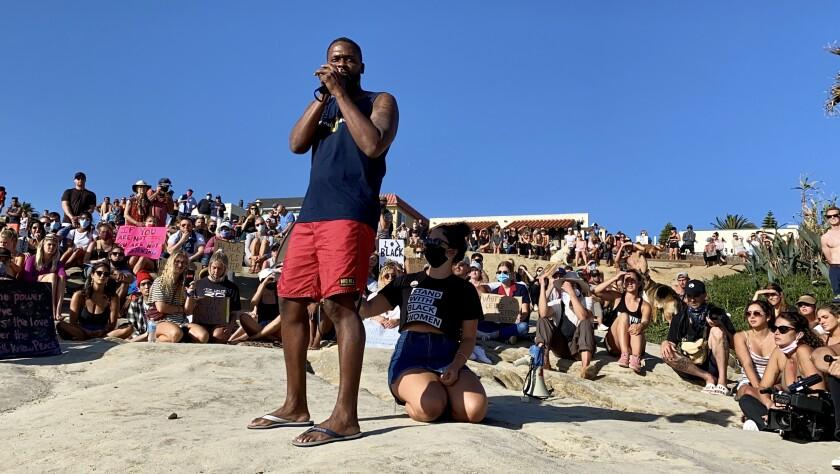 Local attorney and activist Dante Pride addresses protesters at Windansea Beach on June 8.