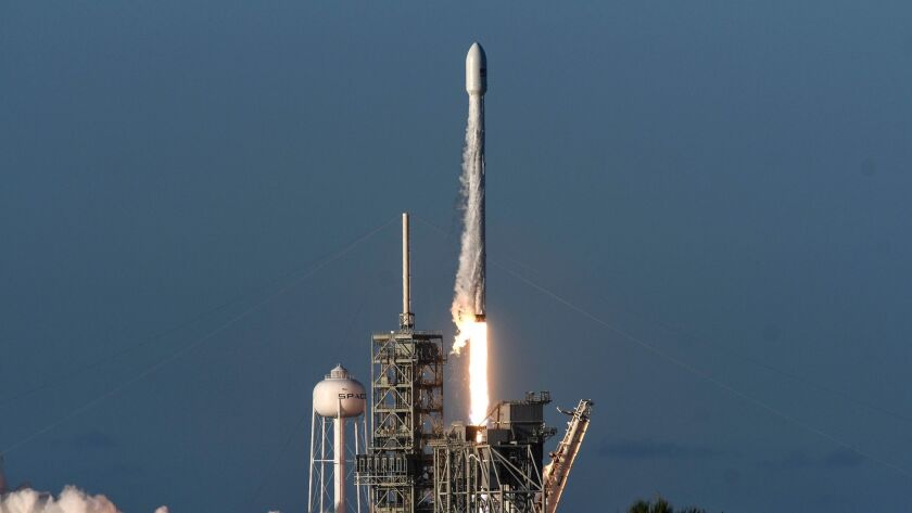 A SpaceX Falcon 9 rocket lifts off from Kennedy Space Center in Cape Canaveral, Fla., Wednesday, Jul