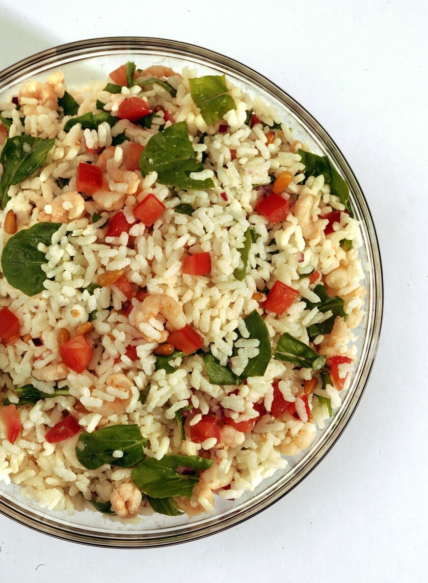 Recipe: Rice salad with arugula and tomatoes.