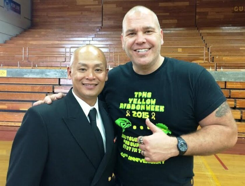 Cmdr. Andrew Doan, left, with Don Collins, Torrey Pines Teacher of the Year and PALS adviser.