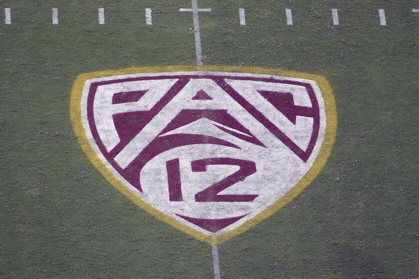 FILE - In this Aug. 29, 2019, file photo, the Pac-12 logo is displayed on the field at Sun Devil Stadium during an NCAA college football game between Arizona State and Kent State in Tempe, Ariz. The Pac-12 hired sports entertainment executive George Kliavkoff to be the conference's next commissioner on Thursday, May 13, 2021, replacing Larry Scott with a person with a similar resume short on college sports experience. (AP Photo/Ralph Freso, File)