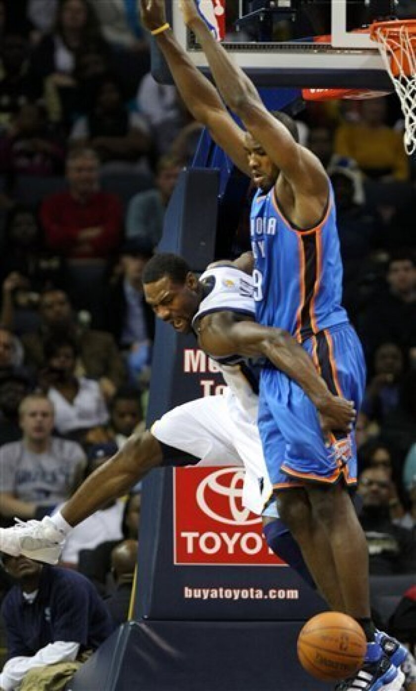 Memphis Grizzlies guard Tony Allen, left, collides with Oklahoma City Thunder forward Serge Ibaka (9) from the Republic of Congo in the second half of an NBA basketball game Tuesday, Jan. 4, 2011 in Memphis, Tenn. The Grizzlies beat the Thunder 110-105. (AP Photo/Jim Weber)
