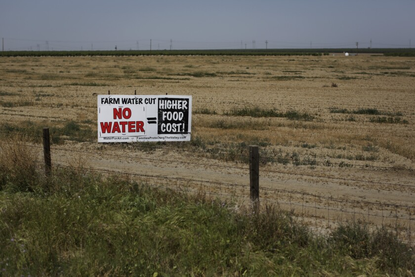 A sign along Interstate 5 in Coalinga, Calif., warns of rising food costs because of the drought.