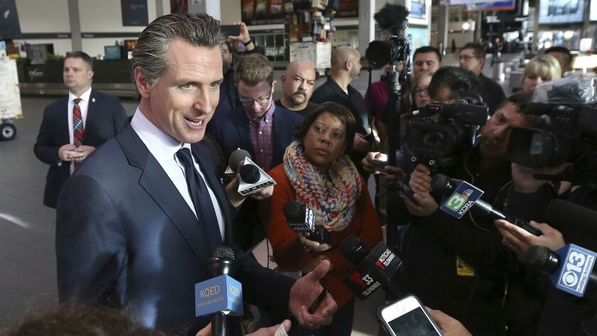Gov. Gavin Newsom says California will offer unemployment benefits to federal employees working without pay after meeting with TSA workers at Sacramento International Airport on Thursday.