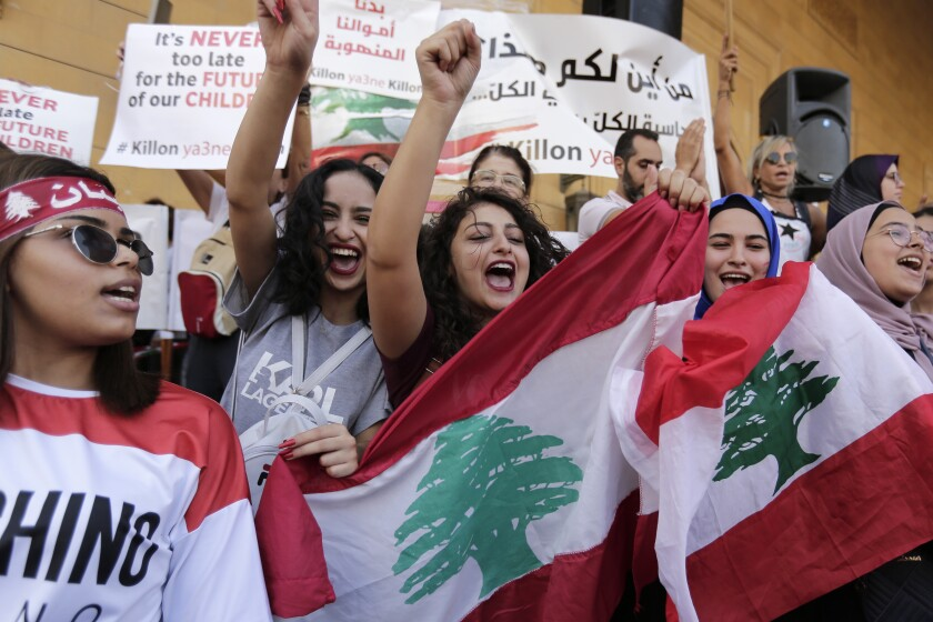 Anti-government protesters shout slogans against the Lebanese government in Beirut, Lebanon, Tuesday, Oct. 22, 2019. Prime Minister Saad Hariri briefed western and Arab ambassadors Tuesday of a reform plan approved by the Cabinet that Lebanon hopes would increase foreign investments to help its struggling economy amid wide skepticism by the public who continued in their protests for the sixth day. (AP Photo/Hassan Ammar)