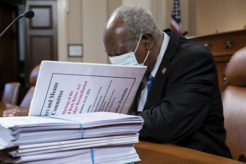 FILE - In this Sept. 14, 2021, file photo Rep. Danny Davis, D-Ill., looks over documents as the tax-writing House Ways and Means Committee continues working on a proposal for tax hikes on big corporations and the wealthy to fund President Joe Biden's $3.5 trillion domestic rebuilding plan, at the Capitol in Washington.. (AP Photo/J. Scott Applewhite, File)