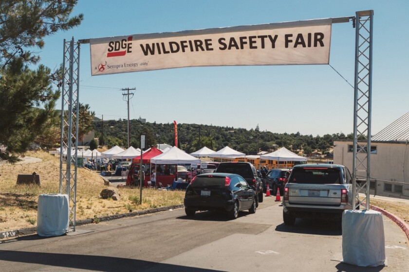 Customers take part in a San Diego Gas & Electric Drive-Thru Wildfire Safety Fair.