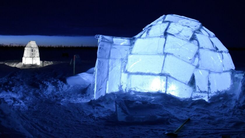 An ice igloo at Tundra North's Aurora Igloo Village atop a frozen lake outside Inuvik in Canada's Northwest Territories.