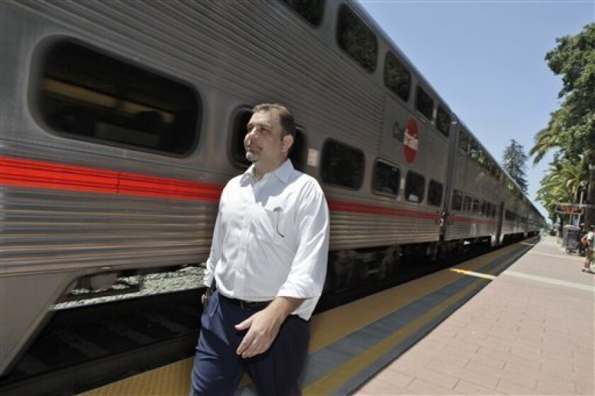 Menlo Park Vice Mayor Richard Cline walks next to an arriving train at the CalTrain station in Menlo Park, Calif., Wednesday, May 20, 2009. Last November, more than 60 percent of voters on the San Francisco Peninsula supported a $9.9 billion bond measure to help pay for a high-speed rail line between San Francisco and the Los Angeles area. (AP Photo/Marcio Jose Sanchez)