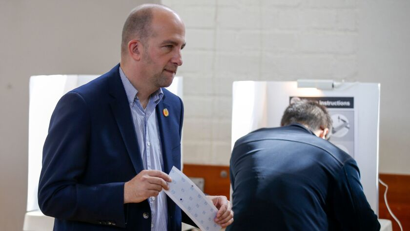 L.A. Unified school board President Steve Zimmer casts his ballot Tuesday at the Hollywood Recreation Center. He finished ahead, but still will face a runoff in May.