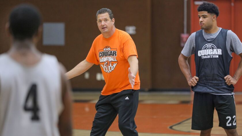 Paul Baldwin, coach of the Escondido High School basketball team, gives instructions during practice.