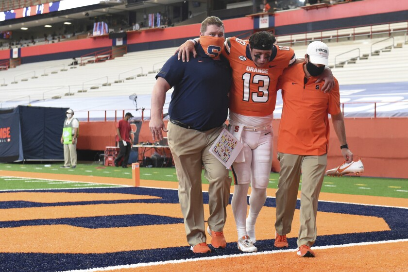 Syracuse= quarterback Tommy DeVito (13) is carried off the field in the second half against Duke during an NCAA college football game, Saturday, Oct 10, 2020, at the Carrier Dome in Syracuse, N.Y. (Dennis Nett/The Post-Standard via AP)