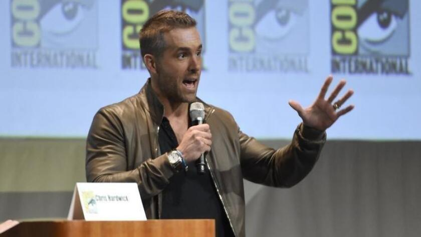 "Ryan Reynolds, who is starring as the title character in ""Deadpool,"" speaks at the Fox presentation at Comic-Con in San Diego (Chris Pizzello / Invision/ Associated Press)"
