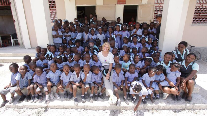 Steph Hoffman, co-founder of Institut Edeline in Croix-des-Bouquets, Haiti, with some of the grade-school's students on a recent visit.