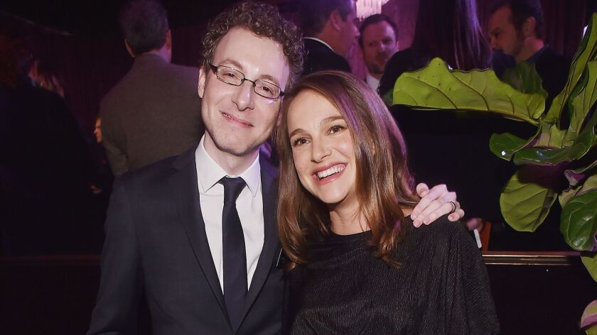 "Composer Nicholas Britell with Natalie Portman at the recent Academy Awards luncheon for nominees in Beverly Hills. Britell scored Portman's directorial debut, ""A Tale of Love and Darkness."""
