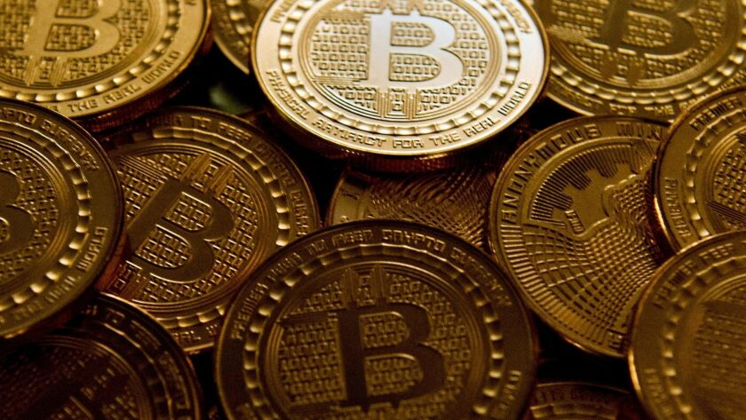 Medallions emblazoned with the bitcoin logo.