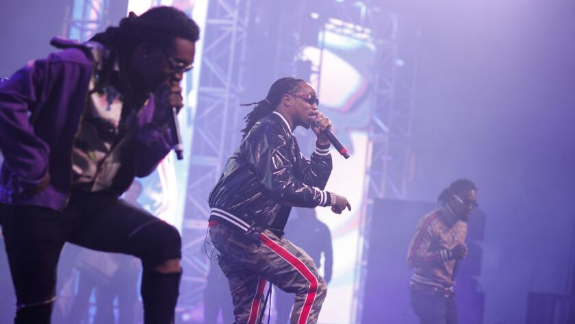 SAN BERNARDINO,CA --SATURDAY, DECEMBER 16, 2017--Takeoff, from left, Quavo and Offset, from the grou