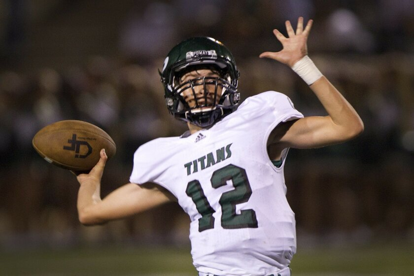 Poway quarterback Gabriel Isaak helped the No. 5-ranked Titans defeat Mt. Carmel 42-7 on Friday in the teams' annual Kiwanis Cup matchup.