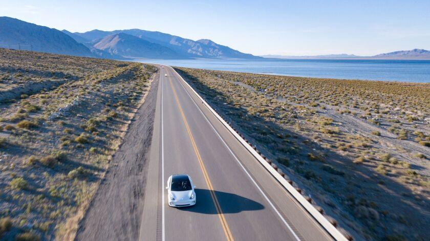 HAWTHORNE, NV – APRIL 23, 2019: Los Angeles Times columnist Chris Erskine drives a Tesla Model 3 on