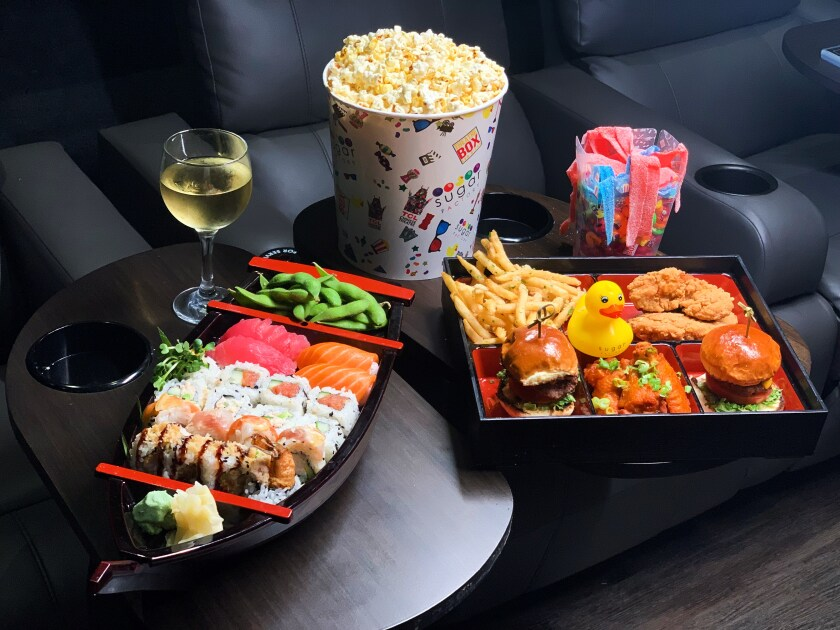 Theatre Box, the luxury dine-in movie house in the Gaslamp, serves everything from sliders to sushi. A $15 ticket to Sunday's Oscars viewing party comes with a reserved seat and two glasses of white, red or sparkling wine.