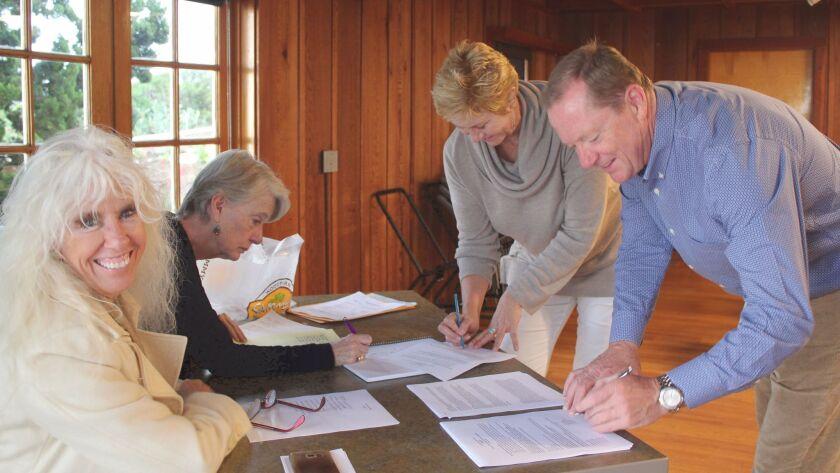La Jolla Shores Association election committee members Terry Kraszewski and Dede Donovan tally the v