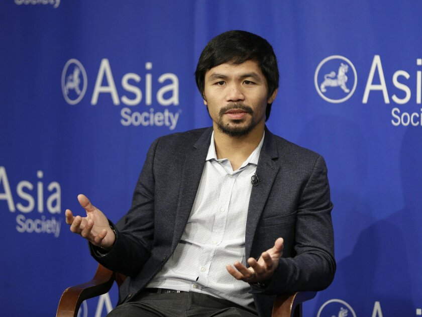 """FILE - In this Oct. 12, 2015, file photo, Manny Pacquiao takes questions at the Asia Society in New York. Boxing star Pacquiao has created a firestorm in his home country after saying people in same-sex relationships """"are worse than animals."""" Pacquiao, who is running for a Philippine Senate seat, m"""