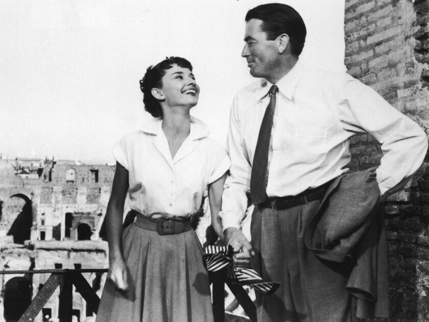 """Audrey Hepburn with Gregory Peck in a still from the 1953 film """"Roman Holiday."""""""