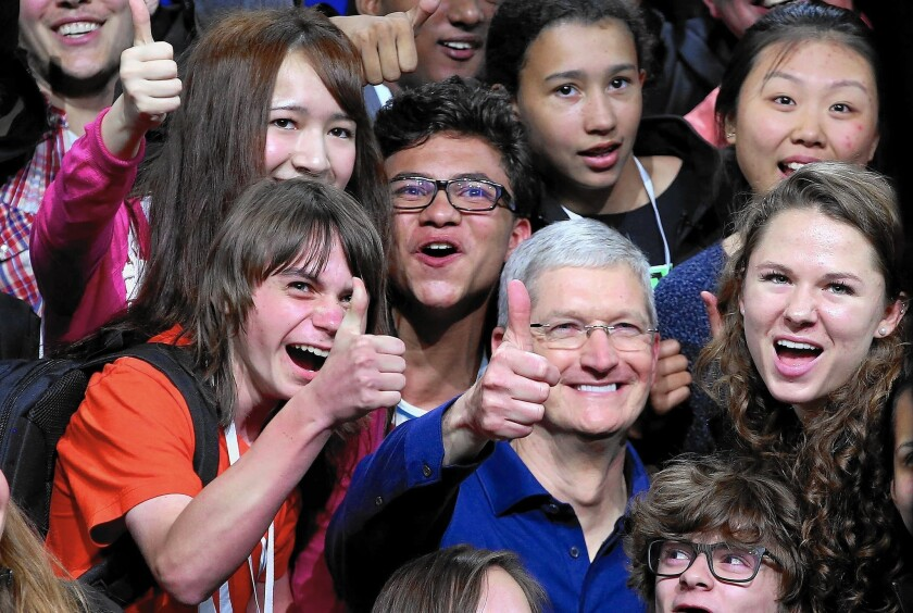 Apple Chief Executive Tim Cook interacts with high-schoolers at an Apple developers' event in June.