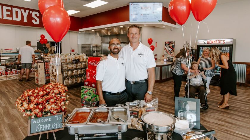 Business partners Mark M. Soto, 34, and John Mayberry, 32, in their newly owned Kennedy's Meat Co. m