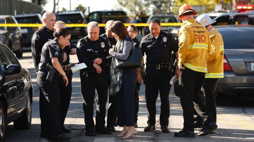 Los Angeles schools are at risk because of inconsistent campus safety measures and a need for more mental health services, according to a report released Monday. Officers manage security at Castro Middle School in Westlake following gunfire that wounded two students in February.
